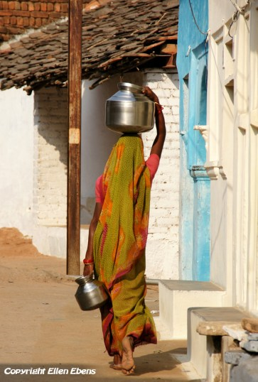 Woman with a water vessel on her head, Khajuraho