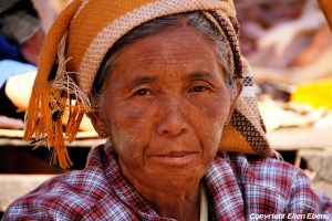 Traditional woman on the market in the city of Pindaya