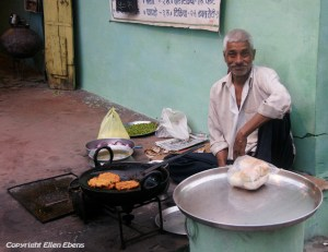 Preparing food on the street in the city of Ujjain