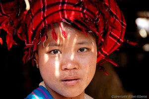 Traditional woman at the five day market of Khaung Daing, Inle Lake
