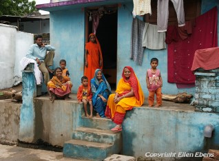 Family in front of their house in the city of Maneshwar