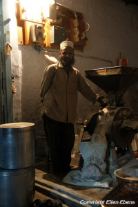A miller in his little shop in the city of Maneshwar