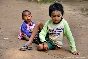 A boy with his baby sister, the city of Amarapura