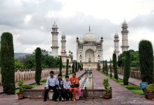 Family posing in front of the Bibi Ka Maqbara in the city of Aurangabad (also called the poor man's Taj)