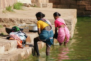 Women washing clothes at the ghats at the small town of Badami