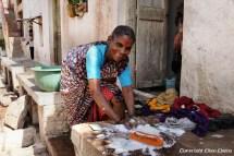 A woman washing clothes at her house at Badami