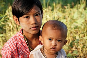 A girl with her baby sister somewhere on the way from Bagan to Mount Popa
