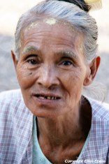 An elderly lady at the city of Paya