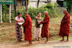 On road from Bago to Kyaikto: monks begging for food