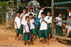 On road from Bago to Kyaikto: children in school uniform at their school