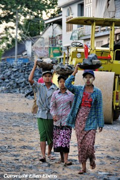 Bago, woman getting stones for road contstruction