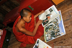 Inle Lake, a young monk reading the football news in the paper at the Shwe Taunghwe Kyaung Monastery
