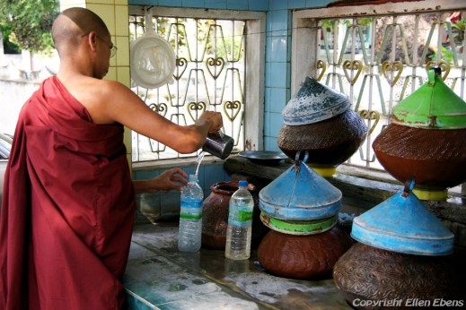 Amarapura, monk filling up his bottle with water at the Mahagandayon Kyaung Monastery