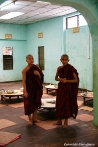 Bago, monks setting the tables at the Kha Khat Wain Monastery