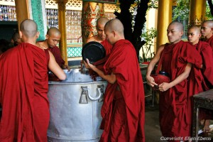 Bago, monks getting rice before going to lunch at the Kha Khat Wain Monaster
