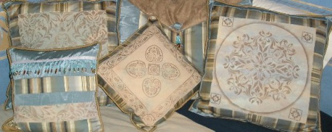 Stenciled and handpainted fabric made into decorative pillows by Ellen Leigh