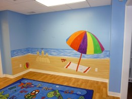 Outdoor cartoon murals in a day care center beach theme