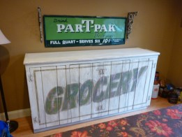 Distressed furniture: cabinet made to look like an old sign