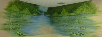 Waterlilies art and a bridge, a soothing mural in a memory care home bathing room. Mural by Ellen Leigh