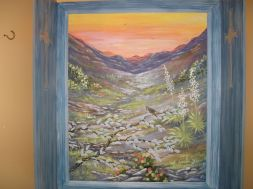 Arizona Window mural in a small powder room, view of the mountains in Arizona, Cactus Wren and Sage, Prickly Pear Cactus. Mural by Ellen Leigh