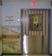 Entry door and mural to the pediatric wing. Mural by Ellen Leigh