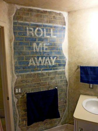 Man Cave bathroom, distressed signage on faux bricks, breakaway concrete mural by Ellen Leigh