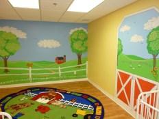 Cartoon baby nursery farm scene in a day care. Mural by Ellen Leigh