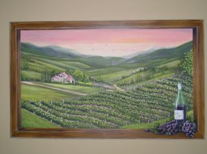 Tuscan Window mural painted to look as though overlooking the Tuscan countryside, owner's home made wine on the window sill. Mural by Ellen Leigh