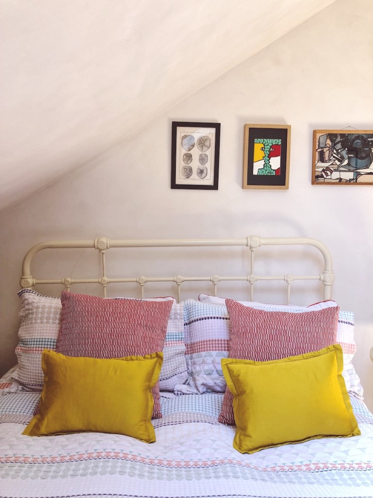 yellow cushions on bed