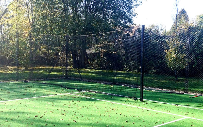 Cricket net folds away easily on a tennis court