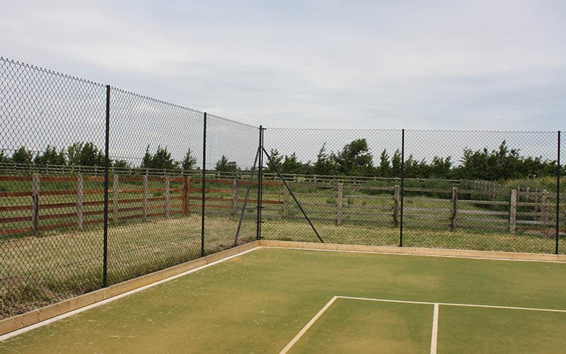 Estate fencing to this court from En Tout Cas