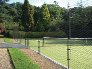 Obelisk fencing keeps the court free from moss
