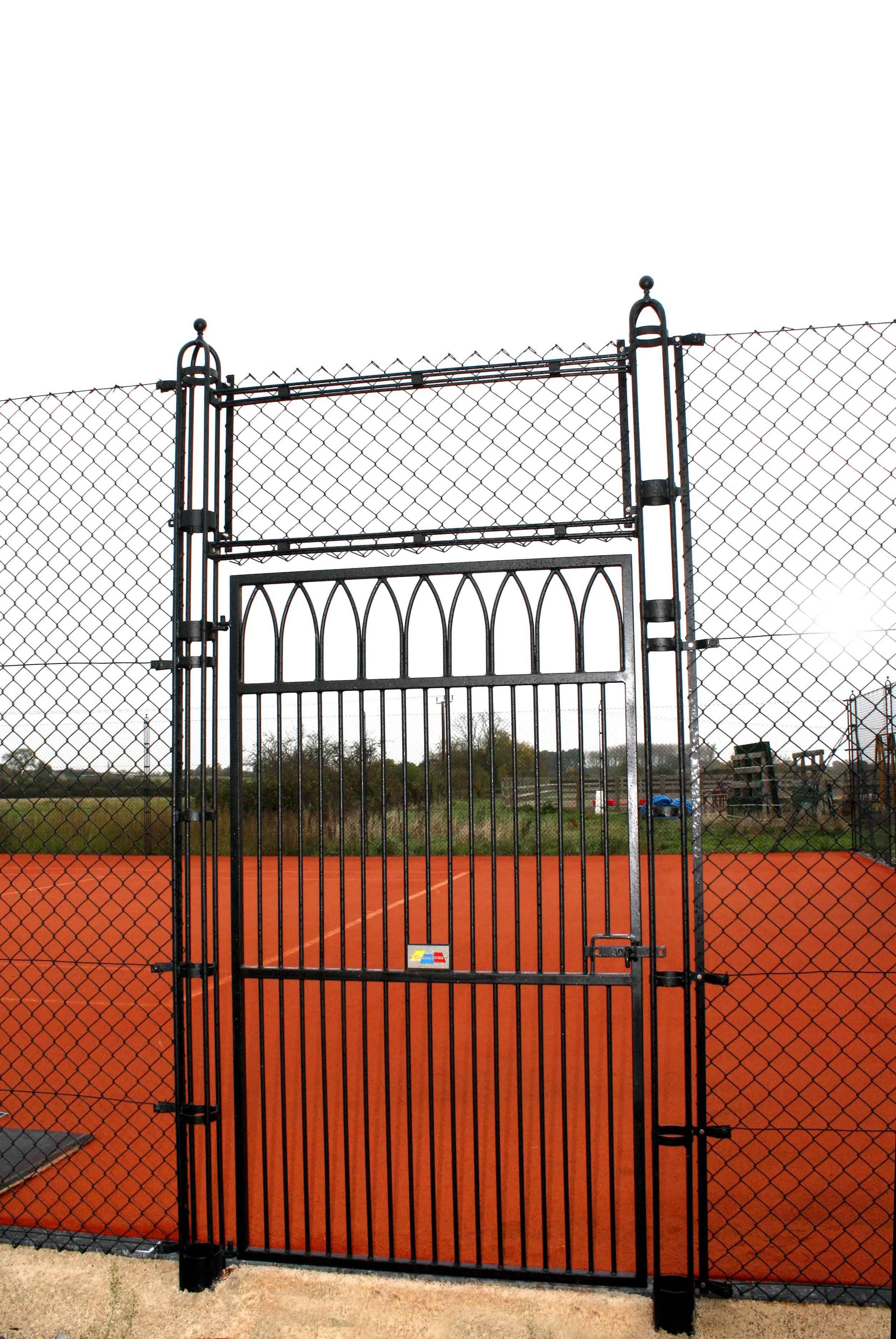 Gothic tennis court gate design by Elliott Courts - EnTC.