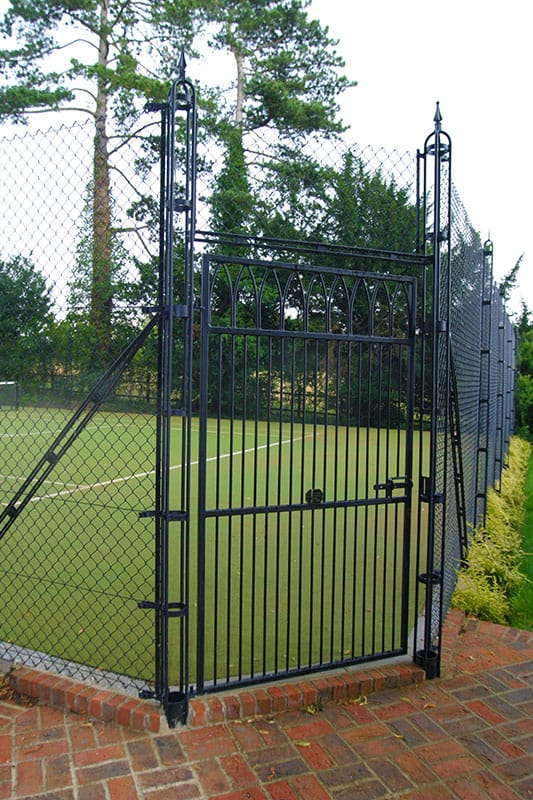 Gothic tennis court gate with a mitred corner - Elliott Courts.