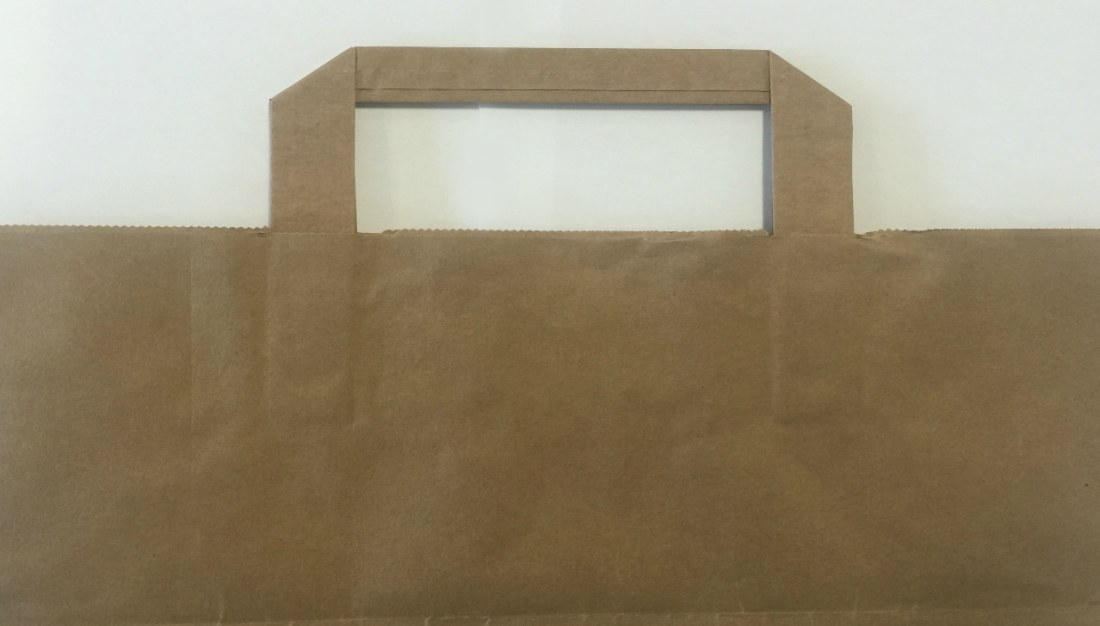 Kraft paper bag with flat tape handles. Brown or white kraft paper. Printed with your logo. Custom take away style bag.