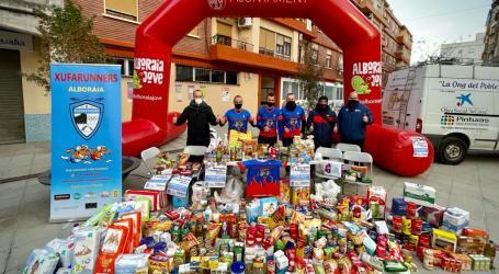 El grupo Xufarunners consigue llenar de alimentos la furgoneta de la ONG Tira Avant Alboraia Solidaria
