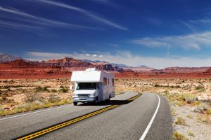 rv traveling on road