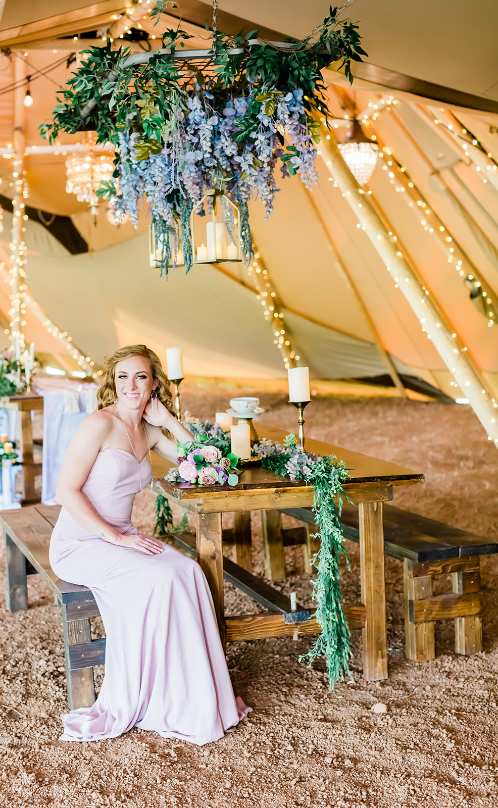 Bridemaid on Farmhouse Wooden Table in Tipi Wedding Festival