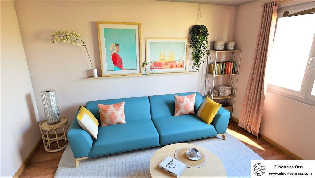 salón estilo vintage sofá azul