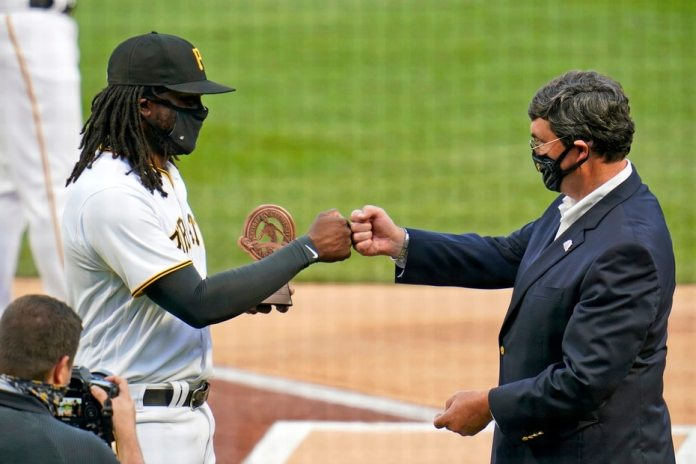 Pittsburgh Pirates first baseman Josh Bell (left) receives a Roberto Clemente Award from franchise owner Bob Nutting before the start of the game against the Chicago White Sox.