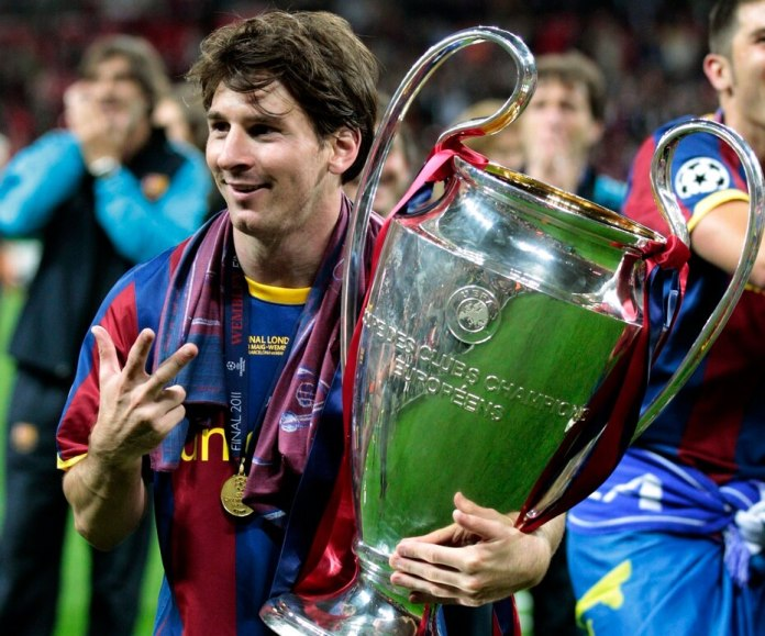 In the photo, he celebrates with the 2011 Champions League Cup.