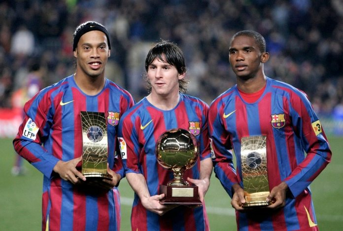 Messi played his first official match with Barcelona in 2004 at the age of 17.  Photo with Brazilian Ronaldinho and Samuel Eto'o of Cameroon in 2005.