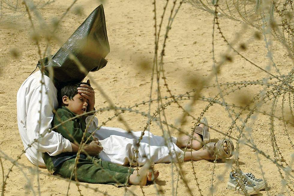 Niño herido, en Irak