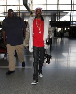 Snoop Dogg y su inseparable guardaespaldas.