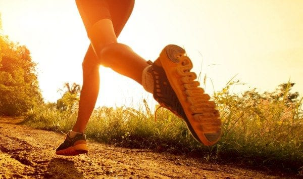 blog picture of lady's legs and feet as she runs on a trail with the sun rising