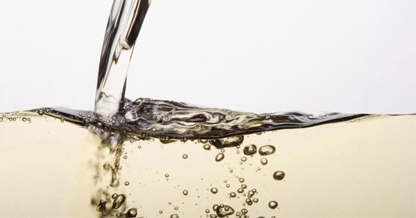 blog picture of white wine being poured