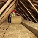 man-installing-insulation