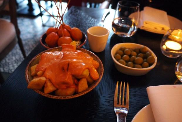 Fried Chorizo Lollipops, Patatas Bravas and olives