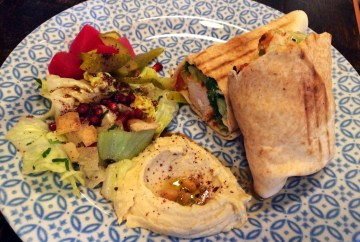 Chicken Kofta wrap with houmous and pickled cucumber and tomatoes