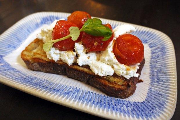 Tomato bruschetta with slow-roasted cherry tomatoes, buffalo ricotta, basil & extra virgin olive oil